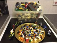 Huge amount of Lego pieces and a large amount of figures