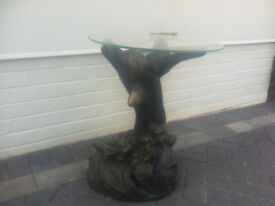 GLASS TOPPED DOLPHIN BASED OCCASIONAL TABLE