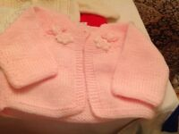 Baby hand knitted cardigans £3 each call 07812980350