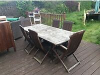 Hard wood garden table and chairs
