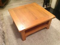 Lovely solid oak coffee table with shelf.