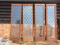 PAIR OF HARDWOOD LEADED LIGHT GLAZED DOORS & TWO MATCHING HARDWOOD LEAD LIGHT GLAZED PANELS