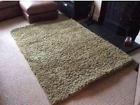 Lime green shag pile rug