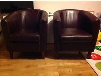 2 dark brown faux leather tub chairs