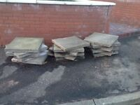 17 used 2x2 paving slabs free to uplift. 2 or 3 bags of concrete sand if you bring bags.