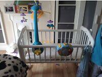 White baby crib and mattress