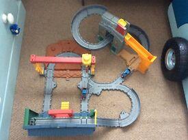 Two Thomas the Tank Engine Train Sets and 2 Thomas trains.