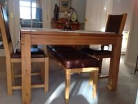 Dining table with matching chairs and bench, solid oak.