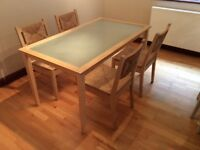 Wooden kitchen table and 4 wicker chairs