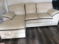 Italian leather 3 seater sofa with chaise and 2 large armchairs. Cream /brown piping.