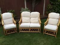 3 piece conservatory furniture set with cream cushions