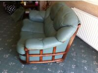 2 x leather 2 seaters plus pouffe