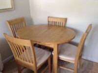 Wooden Dining table + 4 matching chairs. Excellent condition. Folding central leaf to enlarge table.
