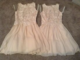 Two peach bridesmaid dresses
