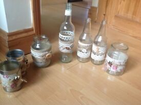 Collection of decorated jars, tins and bottles