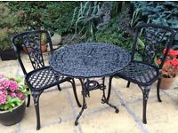 Black wrought iron garden table and chairs