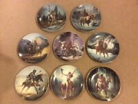 Collection of 8 Native American warrior plates.