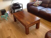 Dark brown wood coffee table, 43 x24 x 16 inches.