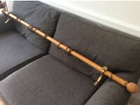 Wooden curtain pole with metal rings