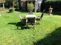 Teak garden set. Table four 4 chairs.