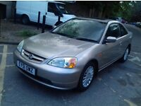 HONDA CIVIC 2001 WITH GENINUE MILEAGE OF 33K, IN EXCELLENT CONDITION
