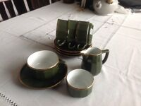 4 dark green coffee cups and saucers