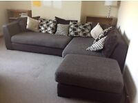Corner sofa and cushions,excellent condition,less than two years old