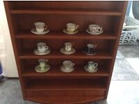 9 miniature cups & saucers & display shelving unit to hang on the wall