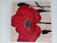 Ceramic poppy tile.