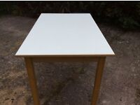 White topped small wooden desk