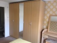 5 door mirrored wardrobe, dressing table, mirror and 2 bedside tables