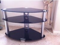 TV stand, black glass, silver legs, perfect condition, 3 tier.