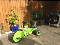 Green machine as in Smyths toys. Good condition