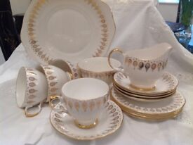 White bone china tea set and sandwich plate