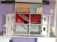 Dolls house with basement. Includes window boxes etc and hanging baskets. Comes with light adaptor.