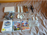 White Ninendo Wii console with accessories and 3 games