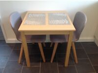 John Lewis Daisy two seater dining table with two Oak Cotta chairs.