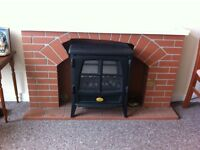 Electric fire with fire place surround brick effect