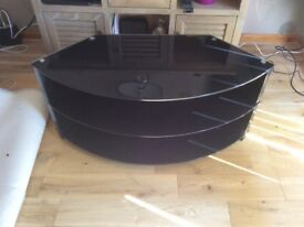 Black glass 3 tier T.V stand.