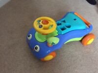 Sit on toy with lift up lid