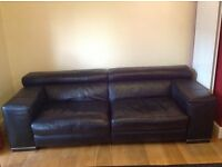 Natuzzi black leather sofa with Ottoman,two sections,2 x electric headrest raising. Good condition