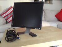 "17"" flat screen computer monitor."