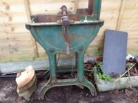Old cast iron knife sharpener used as garden ornament
