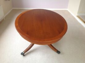 Oval reproduction yew coffee table
