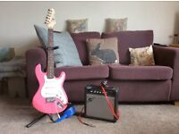 Pink electric guitar with amp