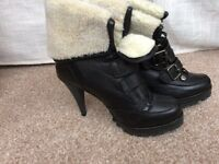 Ladies size 4 leather and sheepskin ankle boots