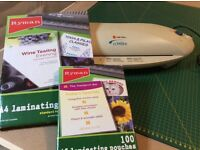 Laminator with 2 packs of laminating pouches