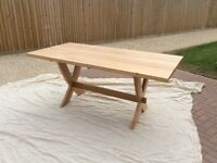 Solid oak crossed leg dining table