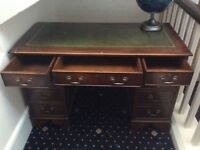 Office style reproduction desk with two banks of side drawers