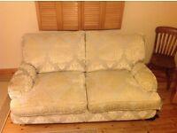 Cream 2/3 seater sofa feather cushions
